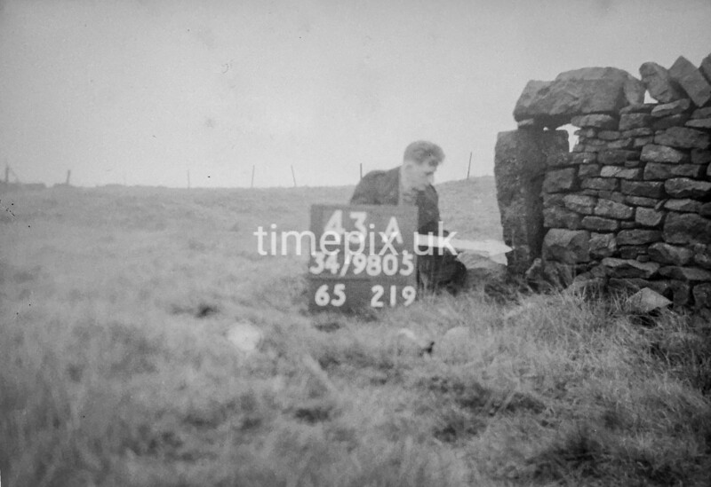 SD980543A, Man marking Ordnance Survey minor control revision point with an arrow in 1950s