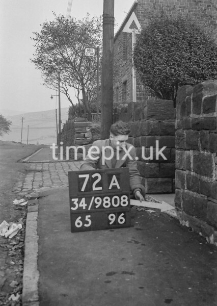 SD980872A, Man marking Ordnance Survey minor control revision point with an arrow in 1950s
