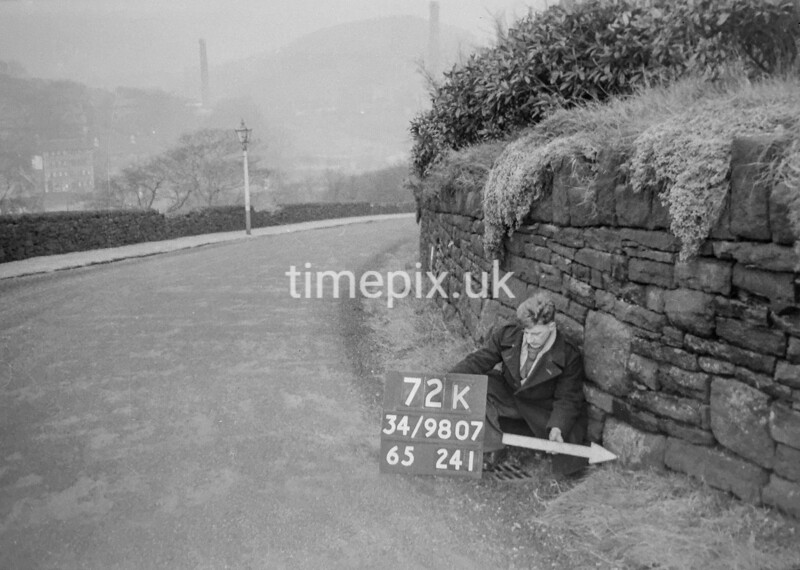 SD980772K, Man marking Ordnance Survey minor control revision point with an arrow in 1950s