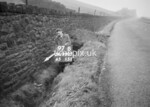 SD990797B, Man marking Ordnance Survey minor control revision point with an arrow in 1950s