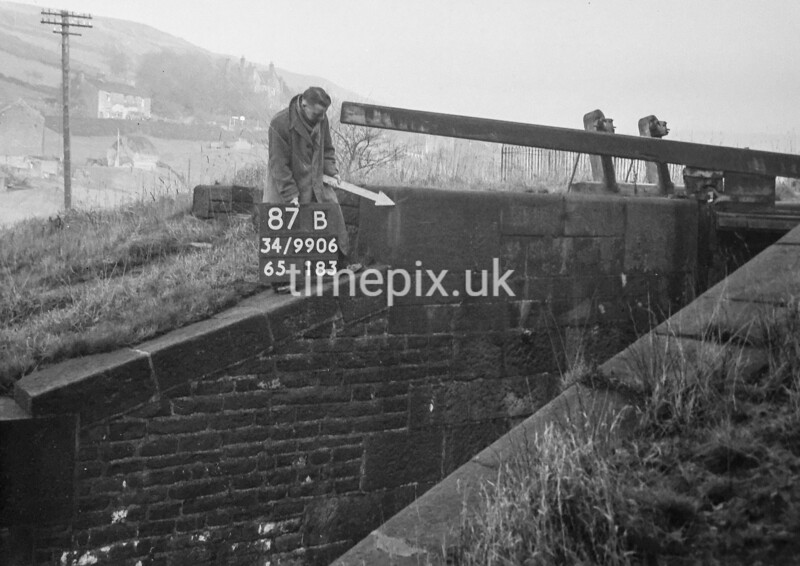 SD990687B, Man marking Ordnance Survey minor control revision point with an arrow in 1950s