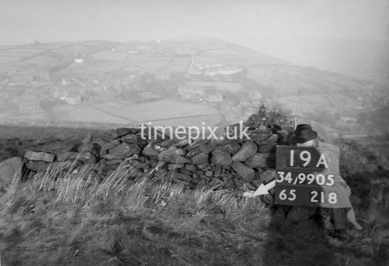 SD990519A, Man marking Ordnance Survey minor control revision point with an arrow in 1950s