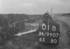 SD990701B, Man marking Ordnance Survey minor control revision point with an arrow in 1950s