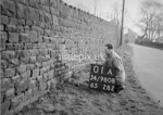 SD980801A2, Man marking Ordnance Survey minor control revision point with an arrow in 1950s