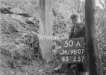 SD980750A, Man marking Ordnance Survey minor control revision point with an arrow in 1950s