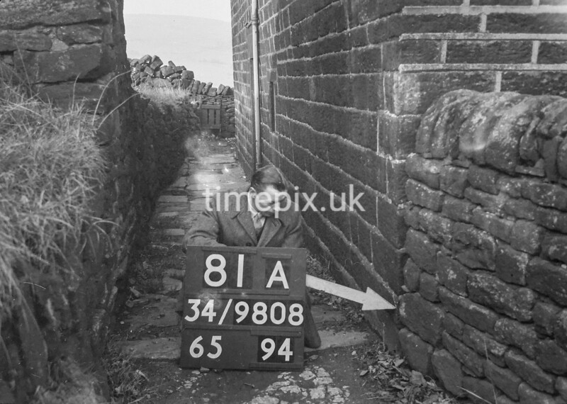 SD980881A, Man marking Ordnance Survey minor control revision point with an arrow in 1950s