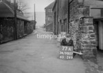 SD980777A1, Man marking Ordnance Survey minor control revision point with an arrow in 1950s