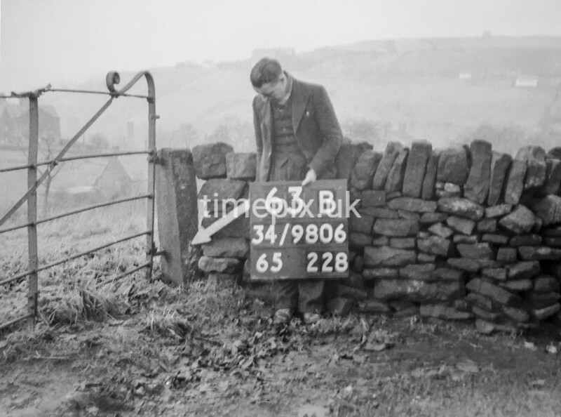 SD980663B, Man marking Ordnance Survey minor control revision point with an arrow in 1950s