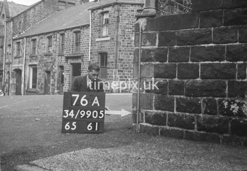 SD990576A, Man marking Ordnance Survey minor control revision point with an arrow in 1950s