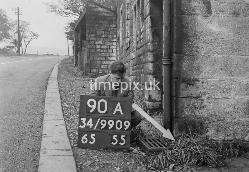 SD990990A, Man marking Ordnance Survey minor control revision point with an arrow in 1950s