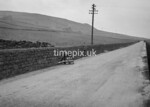 SD990960A, Man marking Ordnance Survey minor control revision point with an arrow in 1950s