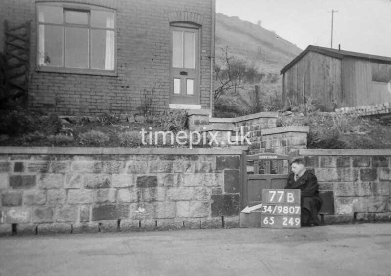 SD980777B, Man marking Ordnance Survey minor control revision point with an arrow in 1950s