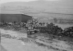 SD990900A, Man marking Ordnance Survey minor control revision point with an arrow in 1950s