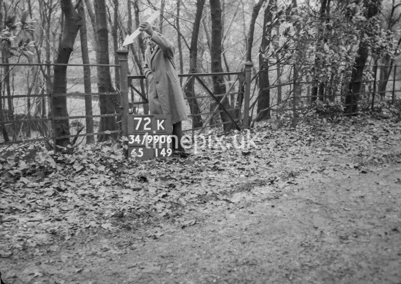 SD990672K2, Man marking Ordnance Survey minor control revision point with an arrow in 1950s