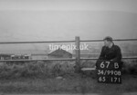 SD990867B, Man marking Ordnance Survey minor control revision point with an arrow in 1950s