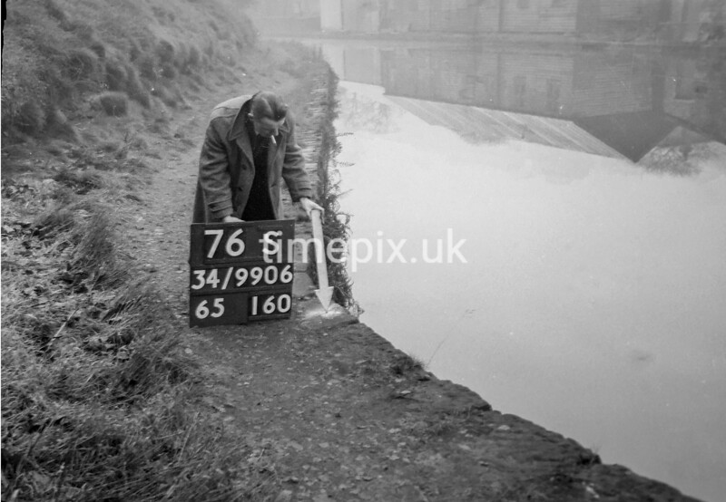 SD990676S, Man marking Ordnance Survey minor control revision point with an arrow in 1950s