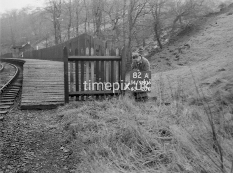 SD980682A, Man marking Ordnance Survey minor control revision point with an arrow in 1950s