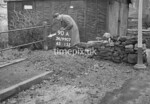 SD990790A, Man marking Ordnance Survey minor control revision point with an arrow in 1950s
