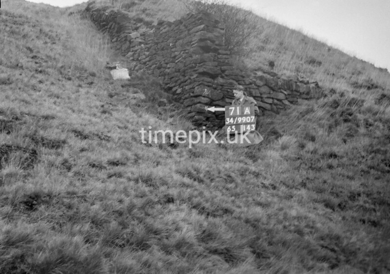 SD990771A2, Man marking Ordnance Survey minor control revision point with an arrow in 1950s