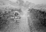 SD980889K, Man marking Ordnance Survey minor control revision point with an arrow in 1950s