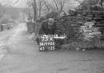 SD990673A, Man marking Ordnance Survey minor control revision point with an arrow in 1950s