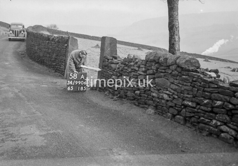 SD990658A1, Man marking Ordnance Survey minor control revision point with an arrow in 1950s