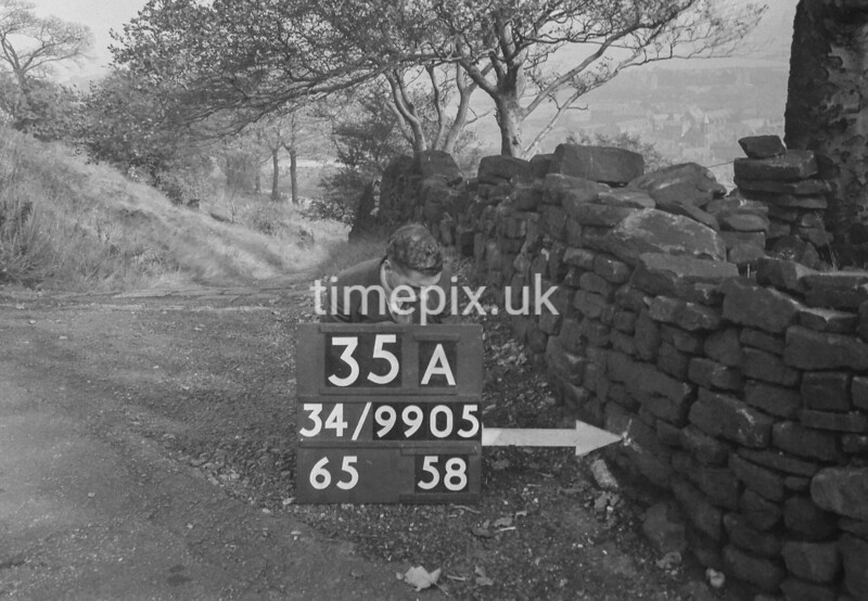 SD990535A3, Man marking Ordnance Survey minor control revision point with an arrow in 1950s