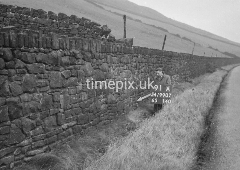 SD990791A, Man marking Ordnance Survey minor control revision point with an arrow in 1950s