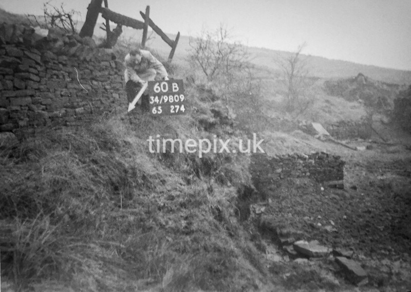 SD980960B, Man marking Ordnance Survey minor control revision point with an arrow in 1950s