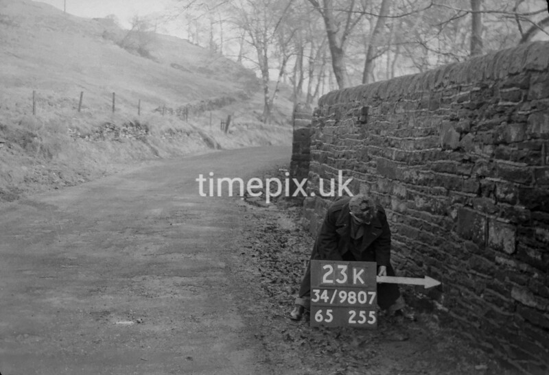 SD980723K, Man marking Ordnance Survey minor control revision point with an arrow in 1950s