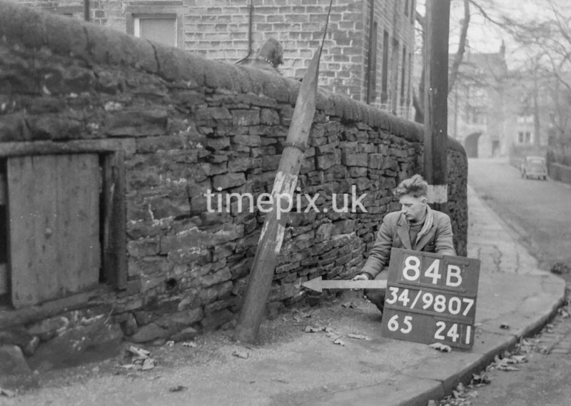 SD980784B, Man marking Ordnance Survey minor control revision point with an arrow in 1950s