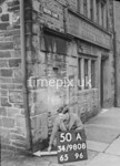 SD980850A, Man marking Ordnance Survey minor control revision point with an arrow in 1950s