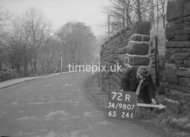 SD980772R, Man marking Ordnance Survey minor control revision point with an arrow in 1950s