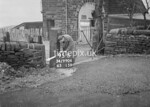SD990695B2, Man marking Ordnance Survey minor control revision point with an arrow in 1950s