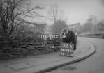 SD980752A, Man marking Ordnance Survey minor control revision point with an arrow in 1950s