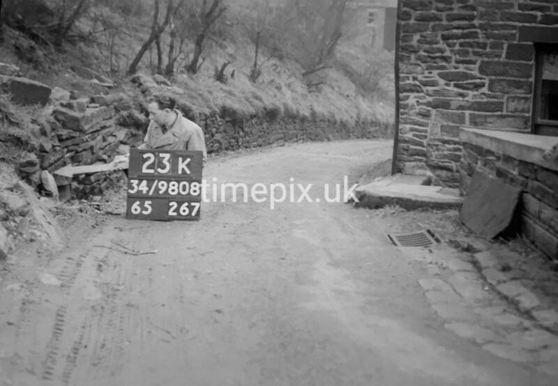 SD980823K, Man marking Ordnance Survey minor control revision point with an arrow in 1950s