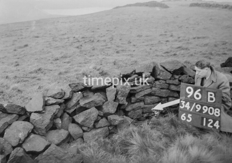 SD990896B, Man marking Ordnance Survey minor control revision point with an arrow in 1950s
