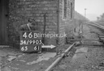 SD990546B, Man marking Ordnance Survey minor control revision point with an arrow in 1950s