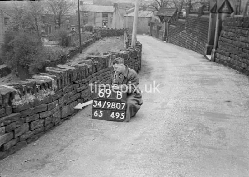 SD980769B2, Man marking Ordnance Survey minor control revision point with an arrow in 1950s
