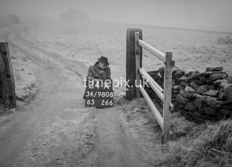 SD980824A, Man marking Ordnance Survey minor control revision point with an arrow in 1950s
