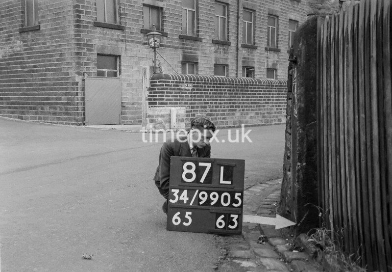 SD990587L, Man marking Ordnance Survey minor control revision point with an arrow in 1950s