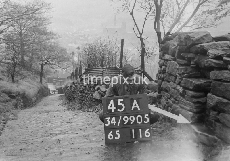 SD990545A, Man marking Ordnance Survey minor control revision point with an arrow in 1950s