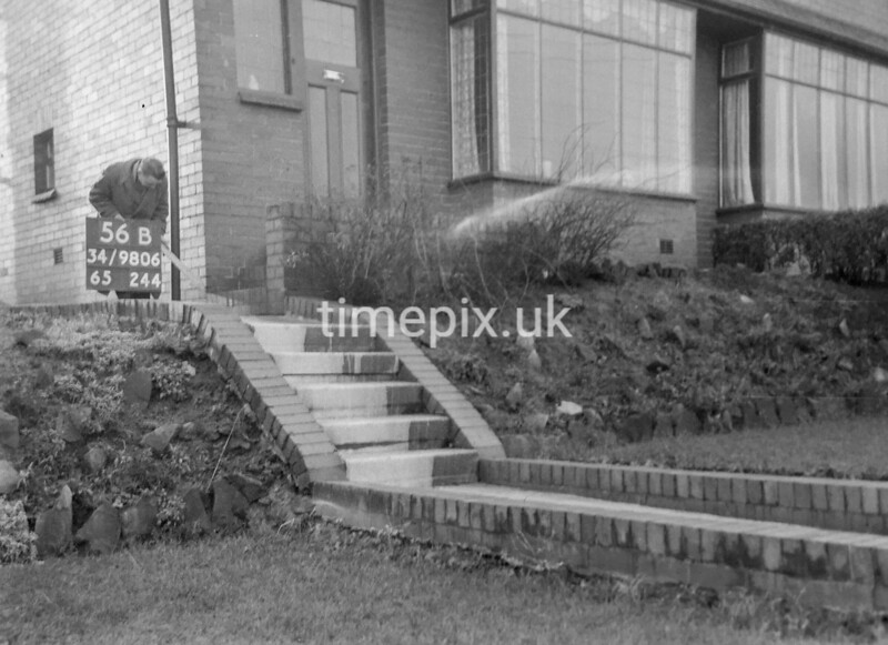 SD980656B, Man marking Ordnance Survey minor control revision point with an arrow in 1950s