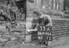 SD990633A, Man marking Ordnance Survey minor control revision point with an arrow in 1950s