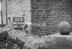 SD990652R2, Man marking Ordnance Survey minor control revision point with an arrow in 1950s