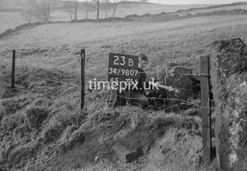 SD980723B, Man marking Ordnance Survey minor control revision point with an arrow in 1950s