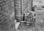SD990607A, Man marking Ordnance Survey minor control revision point with an arrow in 1950s