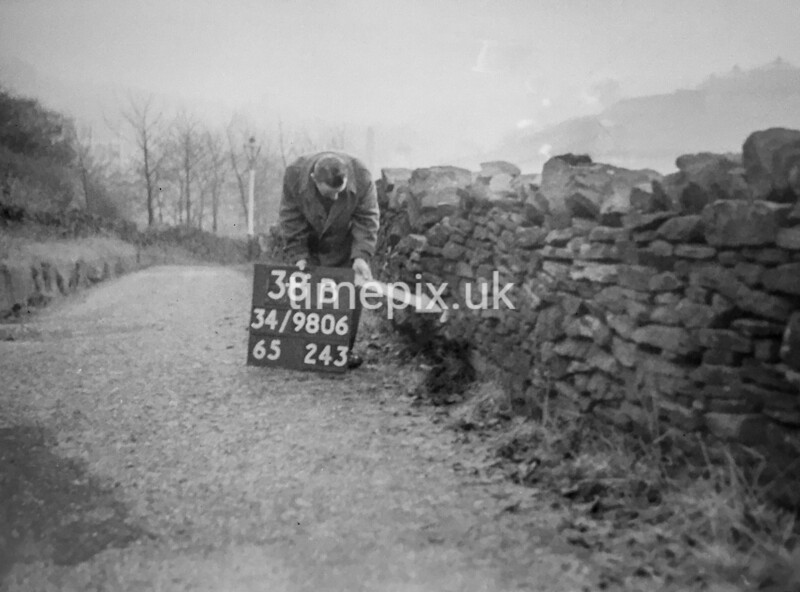 SD980638B, Man marking Ordnance Survey minor control revision point with an arrow in 1950s
