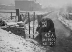 SD980843A, Man marking Ordnance Survey minor control revision point with an arrow in 1950s