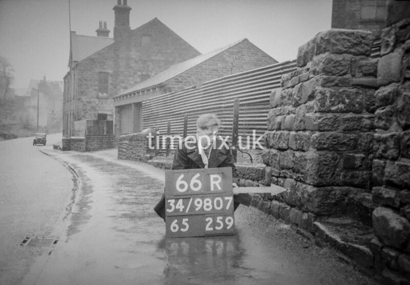 SD980766R, Man marking Ordnance Survey minor control revision point with an arrow in 1950s